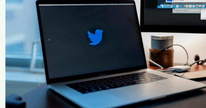 Twitter Logo on black Macbook screen.